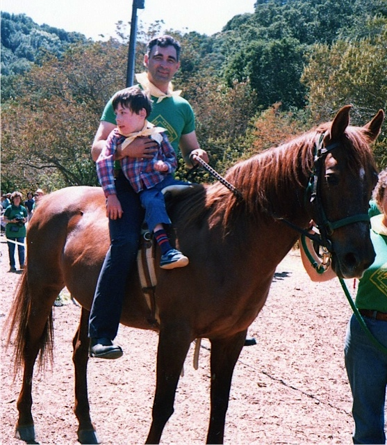 Alan riding with his dad
