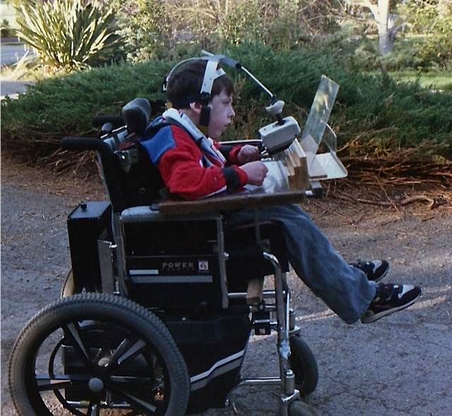 Alan is test driving Ben's power chair.