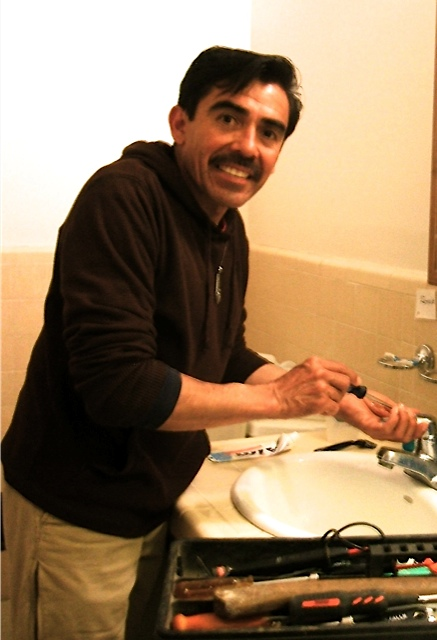 Here he is fixing our bathroom sink.