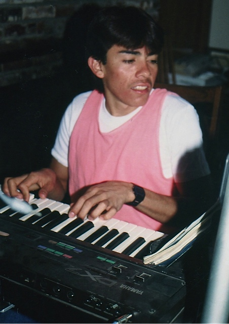 Alberto trying to make music on the keyboard.