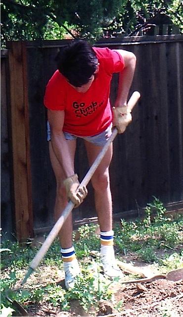 Alberto helping Marian prepare soil for the vegetable garden.