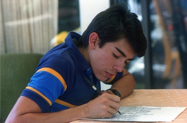 Alberto working on a drawing for his art class..