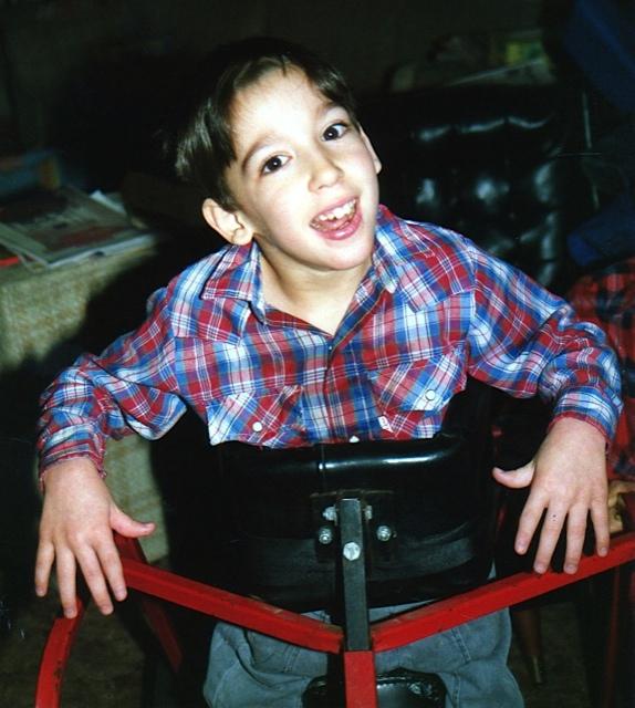 Ben in a specially built walker