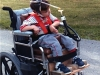 Learning to drive a power wheelchair with a head stick.