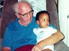 Chris is content sitting on Granddad\'s lap