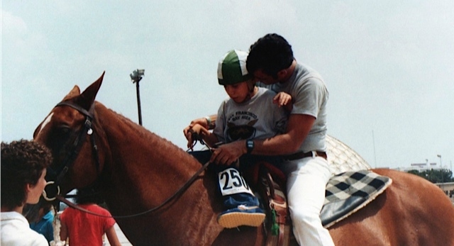 Riding competition in Texas with his dad.