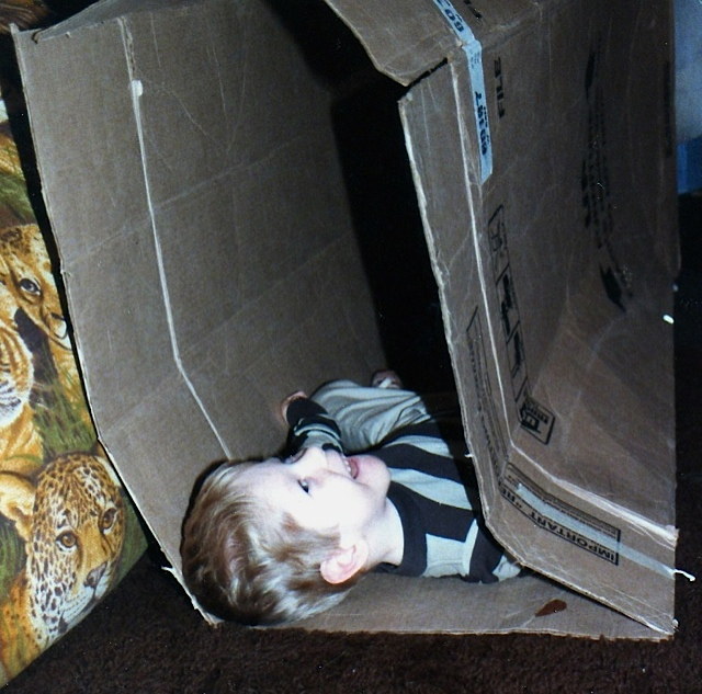 Derek having fun in a large box