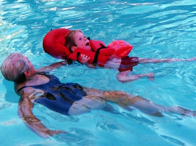 Derek swimming with Grandma