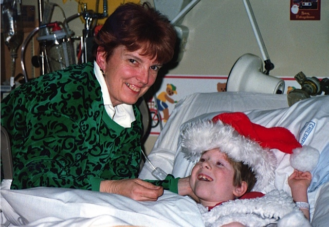 Our friend Diane visits Derek at the hospital.
