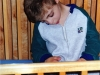 Ilan had great trouble breathing when he slept. So, he usually positioned himself sitting upright against the side of his crib