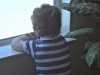 Ilan watching out the window for the school bus