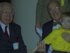 Dr. Taybi holds Ilan while Dr. Rubinstein looks on at the Rubinstein-Taybi Syndrome conference