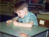 John working hard in school