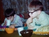 Although John went home to his family for most vacations and summer, he spent many weekends with Marian. Here is John with another classmate snacking on popcorn