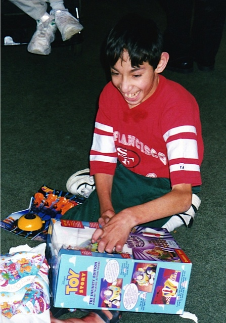 Now, Jose opens his gifts Christmas morning