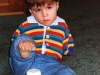 Kolya learns to sit independently and play with toys between 24-26 months.