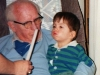 Granddad teaches Kolya to blow out a candle