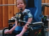 Kyle learns to drive a power chair at 11 months