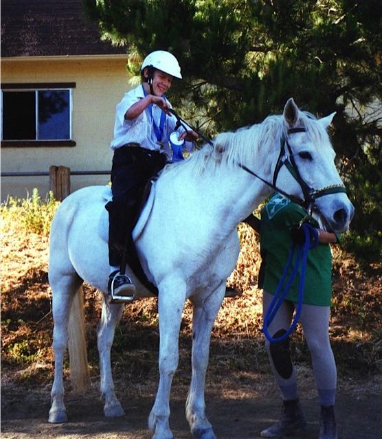 Paul trying to master some horseback riding skills
