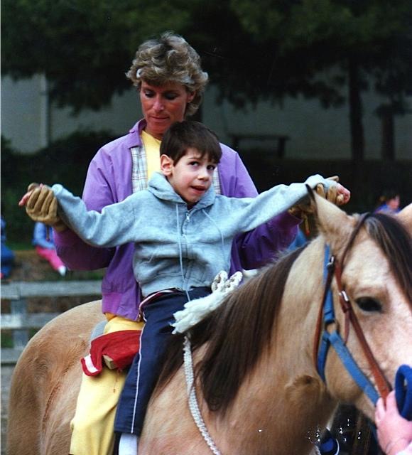 Sean doing range of motion exercises on horseback.