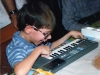 Sean loves to play with keyboards.