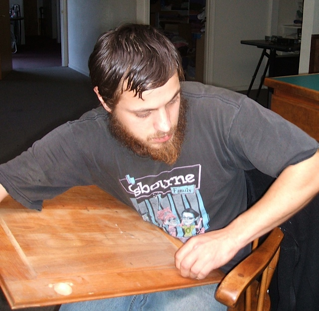Sergei is our fixer upper man. Here he is repairing a hinge on a cabinet door