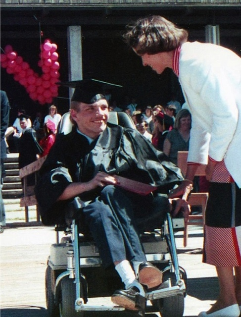 Tom receives his high school diploma