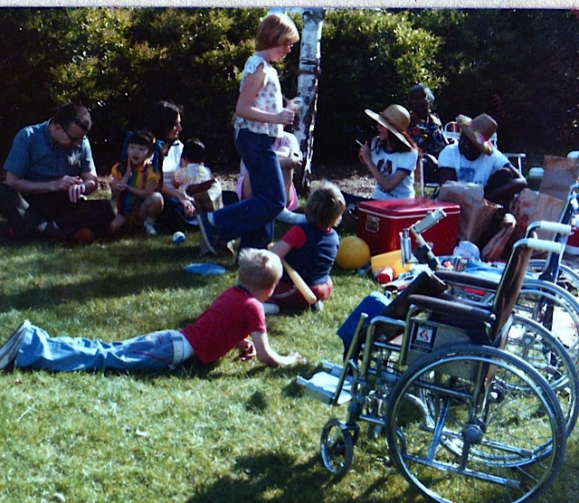 Tom at a picnic with other families who have adopted children