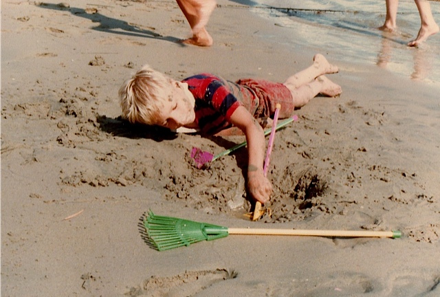 Tom digging in the sand