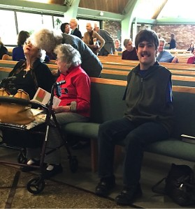 Photo of Kolya Sitting in church, wearing shoes